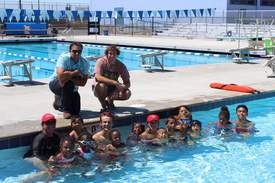 Courtesy ARPD &nbsp&nbsp my brother Scott McDaniels appears on the right hand side while I'm on the left outside the pool. In the pool are ARPD swim instructors and the APC kids who received the scholarships.