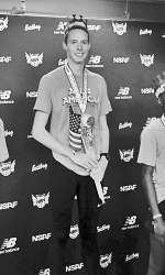 Courtesy photo  Cooper Teare stands atop the podium after the New Balance Indoor National Competition Saturday, March 12, in New York.