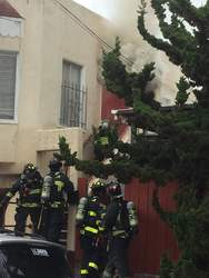Courtesy Alameda Fire Department &nbsp&nbsp Firefighters work to control a fire at a home on the 1400 block of Fifth Street. No one was injured.