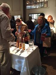 Janet Magleby &nbsp&nbsp Alamedans thronged to the first-ever Whiskey Stroll on Friday, March 2. Above, the stop at Autobody Fine Art served tastes from Fog's End Distillery.